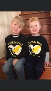 two boys wearing matching t-shirts