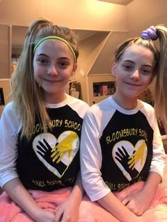 twin girls wearing matching t-shirts